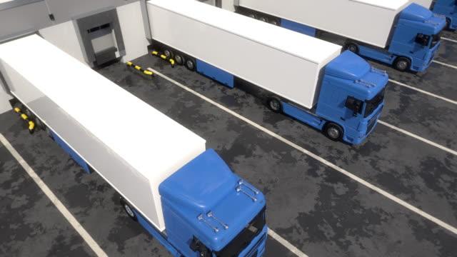 semi trucks at warehouse loading dock - колонна стоковые видео и кадры b-roll