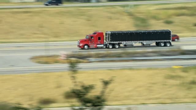 semi with grain trailer on interstate highway video