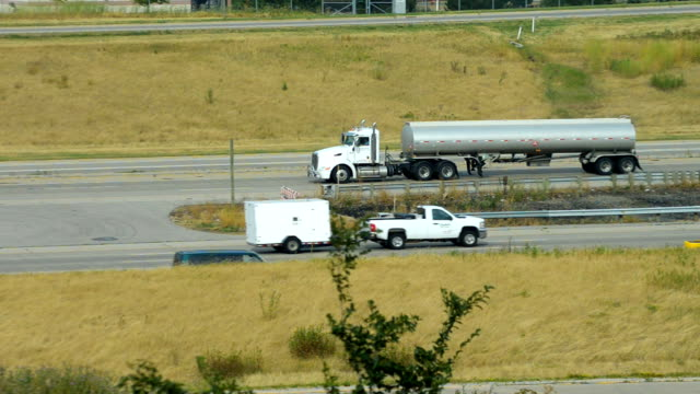 semi with tanker trailer in interstate highway video