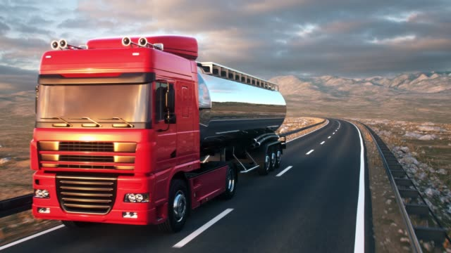 semi-trailer tank truck driving along a desert road A tank truck passes the camera driving on a highway into the sunset, camera moves from low angle front-view upwards to high angle view as the truck passes. Realistic high quality 3d animation. storage tank stock videos & royalty-free footage