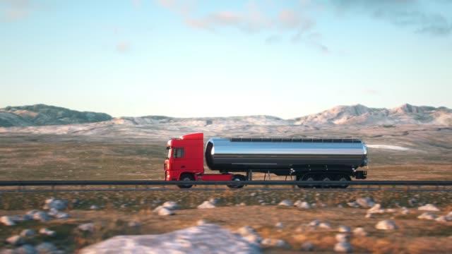semi-trailer tank truck driving along a desert road - nave cisterna video stock e b–roll