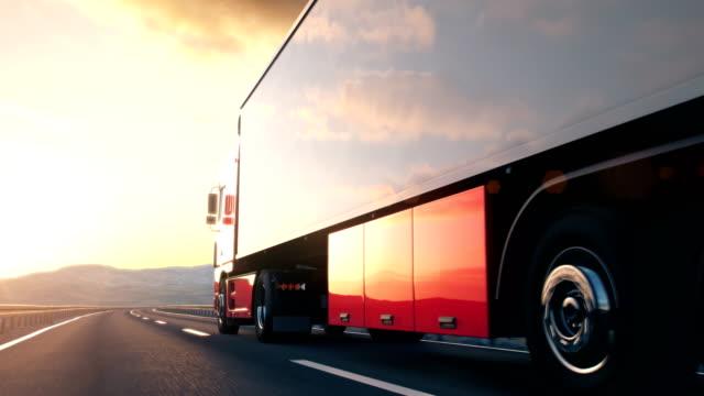 semi-trailer truck driving along a desert road