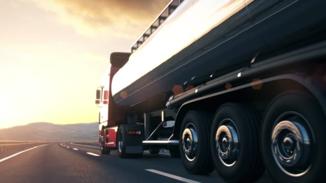 semi-trailer truck driving along a desert road - nave cisterna video stock e b–roll