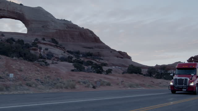 Semi-Truck Driving Down Highway in Southwestern Utah Near Moab and Wilson Arch