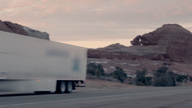 Semi-Truck Driving On Highway in Southwestern Utah Near Moab and Wilson Arch