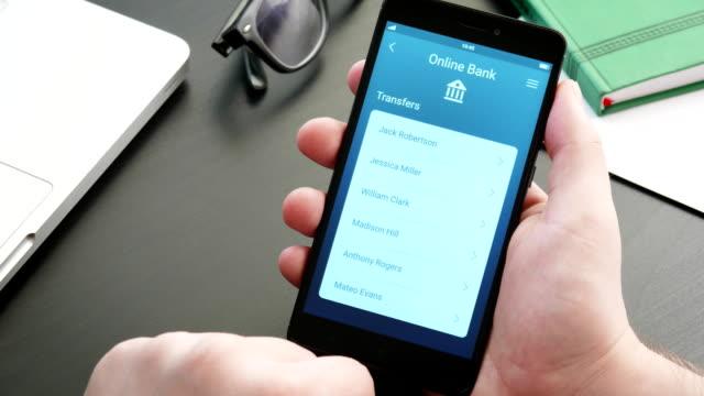 sending money using banking app on the smatphone - conto corrente video stock e b–roll