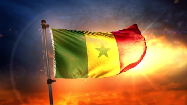 senegal flag backlit at beautiful sunrise loop slow motion 4k - dakar video stock e b–roll