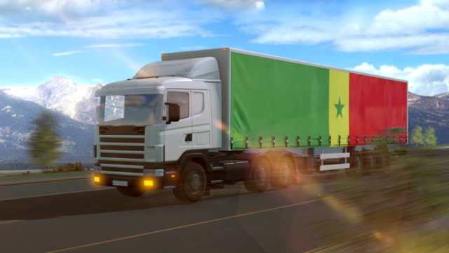 Senegal flag shown on the side of a large truck Senegal flag shown on the side of a large truck driving on a highway senegal stock videos & royalty-free footage