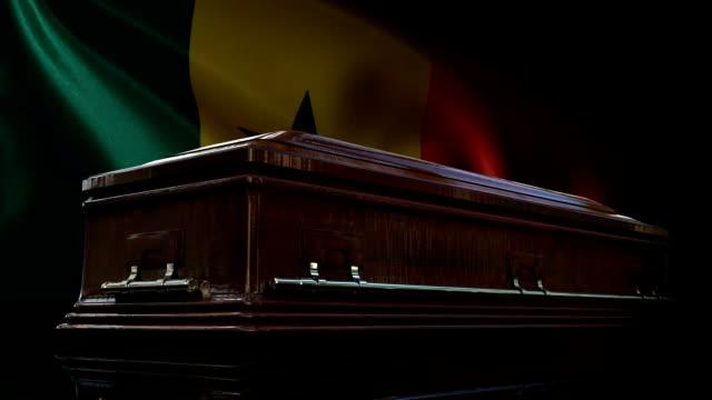 senegalese flag behind coffin - dakar video stock e b–roll