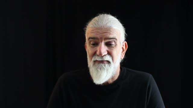 Senior actor practicing facial expressions of despising man video
