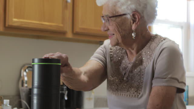 Senior Adult Female in Domestic Residence Kitchen 4K Video