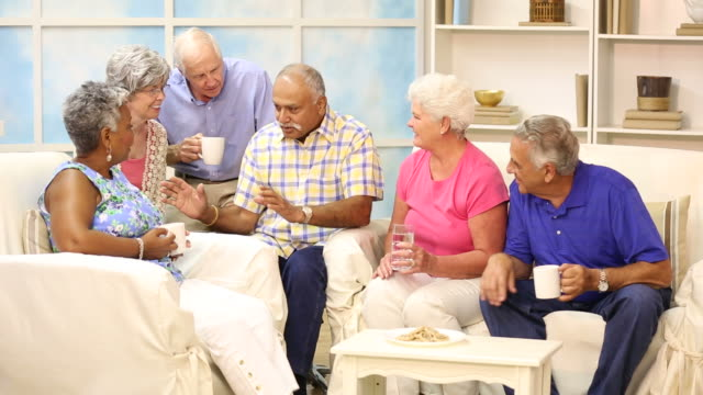 Senior adult friends share news, friendship.  Home or assisted living. video