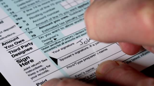 Senior adult man signing tax return video