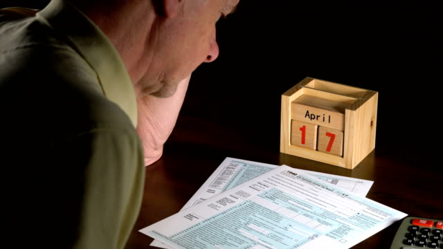 Senior adult man with tax return date of April 17, 2018 video