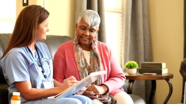 Senior adult woman and home health care nurse. video