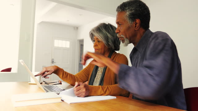 Senior African American Couple Discussing Finances at Home video