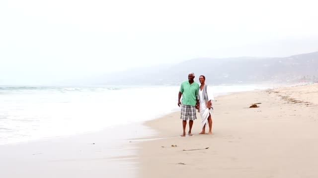 Senior African American couple on sandy beach video