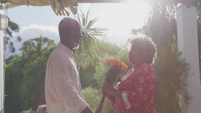 A senior African American couple spending time together in the garden in love