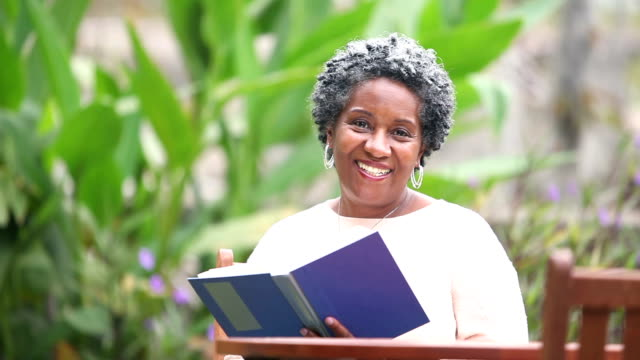 Senior African American woman reading a book video