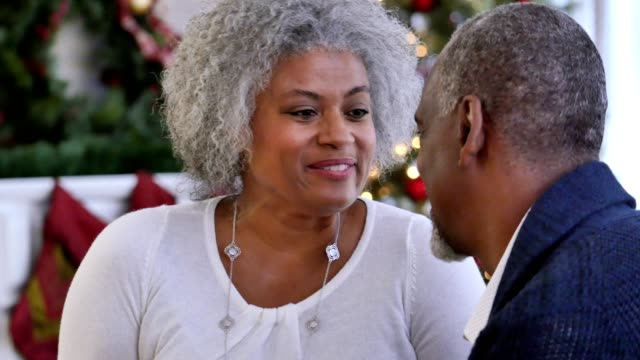 Senior African American woman receives Christmas gift from her husband video