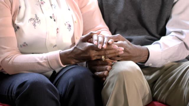 senior african-american couple holding hands - para aranżacja filmów i materiałów b-roll