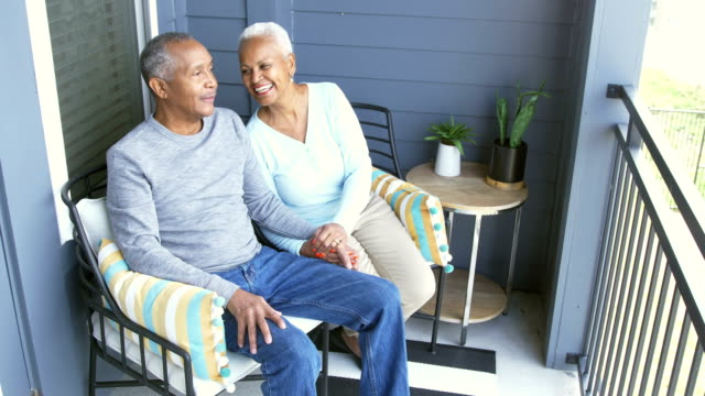 senior african-american couple relaxing on porch - portico video stock e b–roll