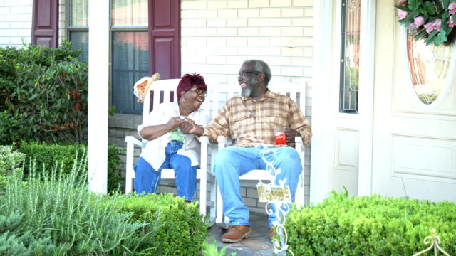 senior african-american couple together on front porch - portico video stock e b–roll