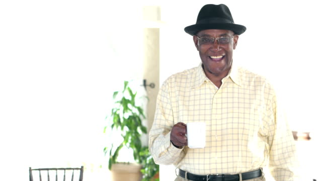 Senior African-American man raising coffee cup for toast video