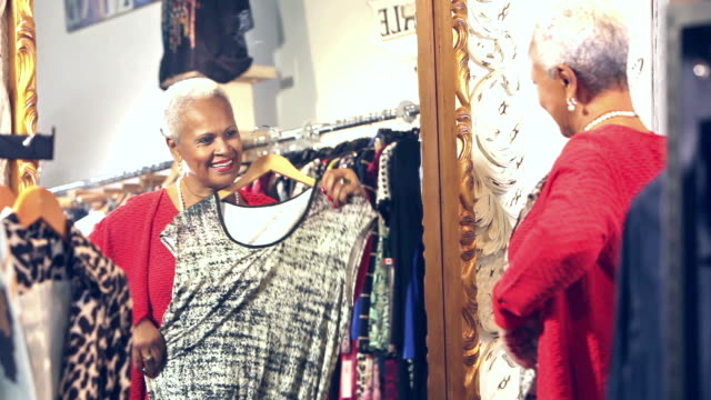 Senior African-American woman shopping for clothing video