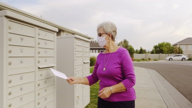 Senior Age Woman Voting by Mail