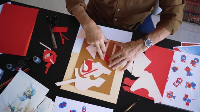 Senior artist in work with collage art video