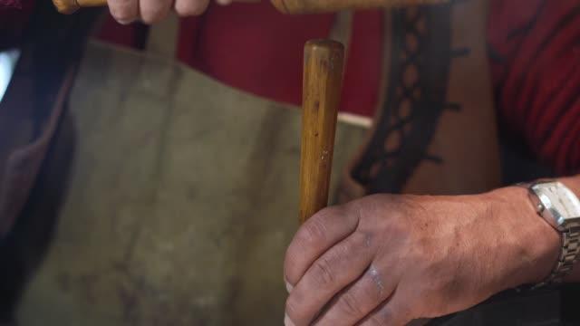Senior artist working in his carpenter studio
