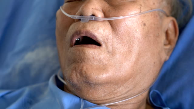 CU Senior Asian male patient mouth feeling hard to breathing Close-up oh Senior Asian male patient mouth feeling hard to breathing medical oxygen equipment stock videos & royalty-free footage