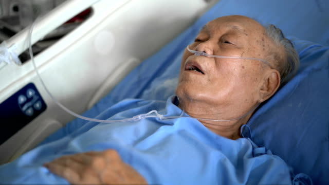 Senior Asian male patient on hospital bed hard breathing Senior Asian male patient on hospital bed hard breathing medical oxygen equipment stock videos & royalty-free footage