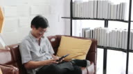 istock Senior Asian man playing tablet and Asian elderly man is Relaxing and Happiness With Video call  on sofa in living room at home 1216076740