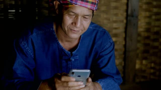 Senior Asian man Using Digital Technology