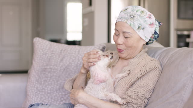 Senior Asian Woman With Cancer At Home