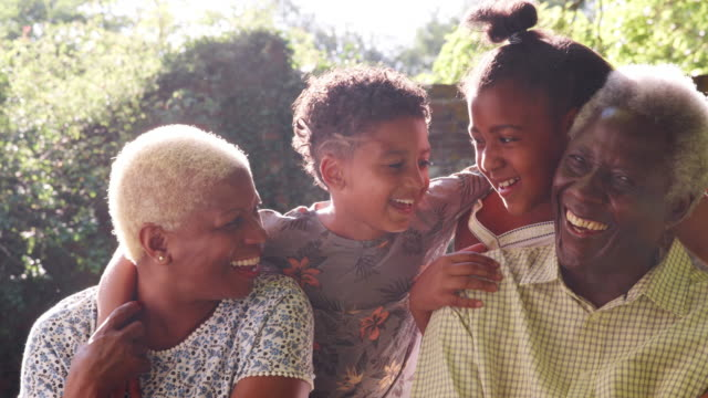 Senior black couple and grandchildren outdoors, close up Senior black couple and grandchildren outdoors, close up granddaughter stock videos & royalty-free footage