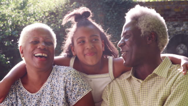 senior black couple and granddaugther outdoors, close up - tre persone video stock e b–roll