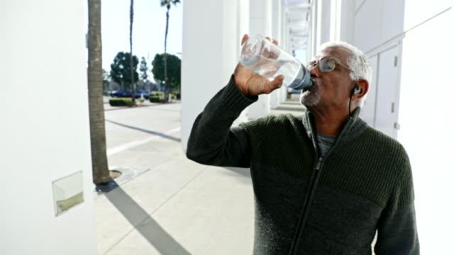 Senior Black Man Drinking Water