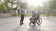 istock Senior Black Man Playing Basketball with daughter in wheelchair 1179842133