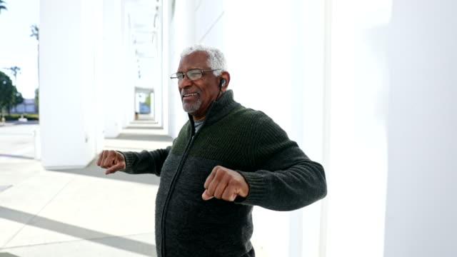 Senior black man stretching before a workout