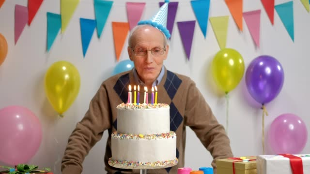 Senior blowing candles on a birthday cake video