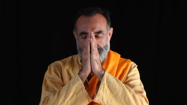 Senior buddhist man praying video