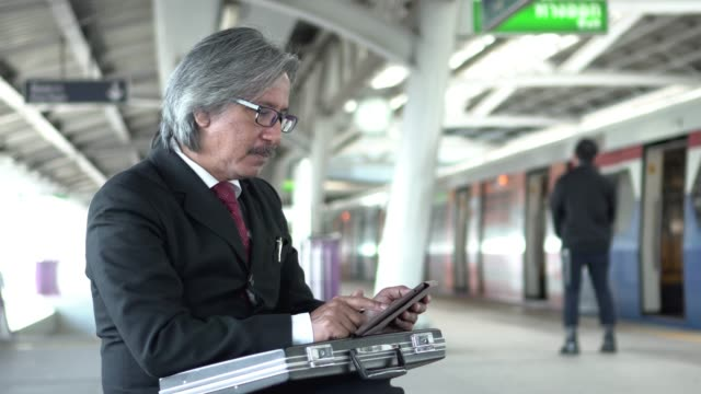 Senior businessman using tablet at train platform Business activity railroad station platform stock videos & royalty-free footage