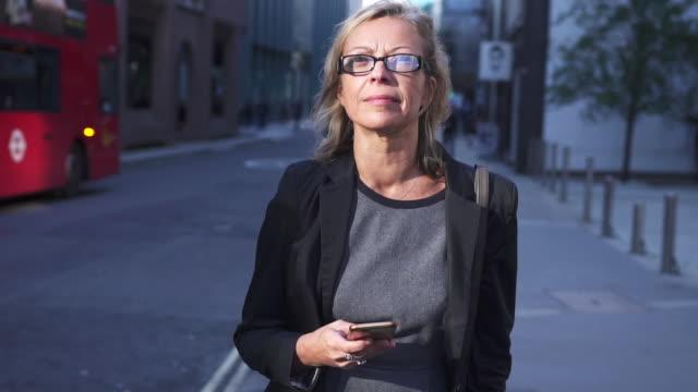 Senior businesswoman using smart phone in London video