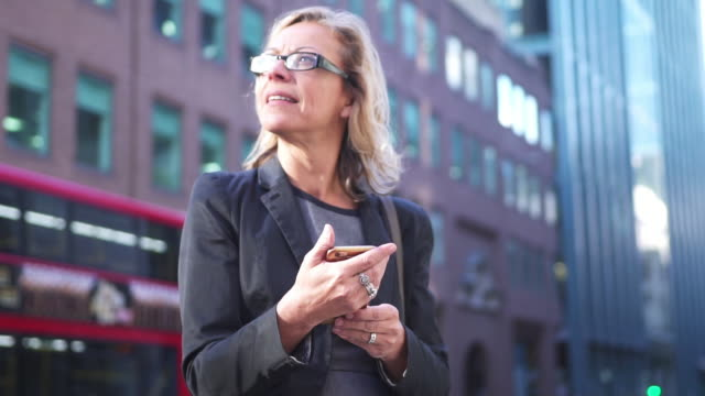 Senior businesswoman using smart phone in London video