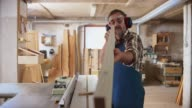 istock LD Senior carpenter checking the plank he just cut on the table saw 1137339955