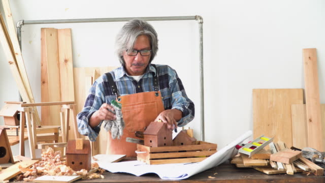 senior carpenter keeping his equipment tool in wooden box in the workshop house