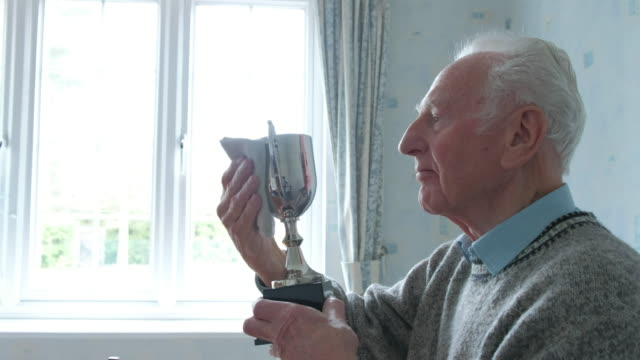 senior caucasian man cleaning his trophy - championship stock videos & royalty-free footage
